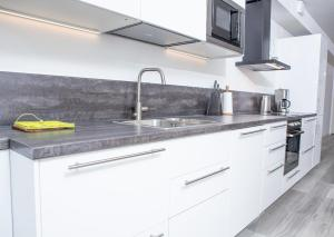 A kitchen or kitchenette at Riverside Residences