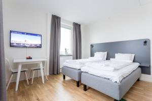 A bed or beds in a room at ApartDirect Linköping Arena