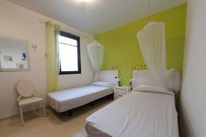 Ein Bett oder Betten in einem Zimmer der Unterkunft Villa Alba de Luxe