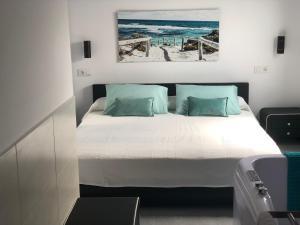 Cama o camas de una habitación en Suites D'Elice