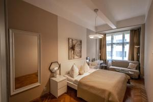 A bed or beds in a room at Design Apartment by Ruterra