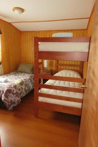 A bunk bed or bunk beds in a room at Departamentos Emanuel