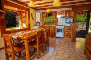 A kitchen or kitchenette at Costa Brava Apart Hotel
