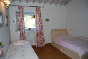 A bed or beds in a room at Villa La Grisa