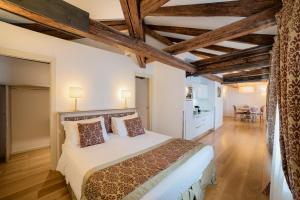 A bed or beds in a room at Al Redentore Di Venezia