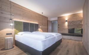 Postel nebo postele na pokoji v ubytování Ahrner Wirt Apartments