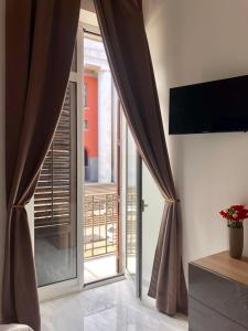 A balcony or terrace at Palazzo Caltagirone Apartments