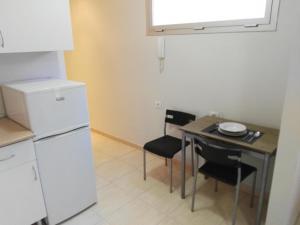 Virtuve vai virtuves aprīkojums naktsmītnē Estudios Cientouno