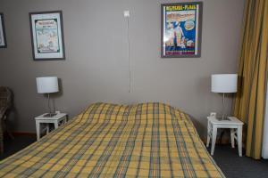 Een bed of bedden in een kamer bij Apparthotel De Wielingen