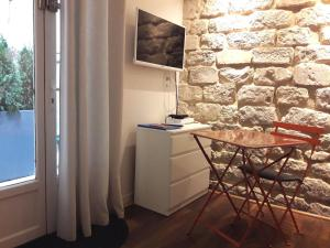 A television and/or entertainment center at In the heart of Montmartre