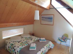 Кровать или кровати в номере La maison des bois flottés
