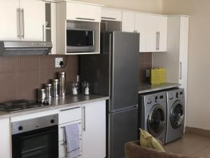 A kitchen or kitchenette at Windhoek Central Self Cater apartment at Bergdoring