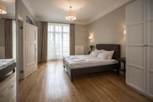 Lova arba lovos apgyvendinimo įstaigoje Riga Lux Apartments - Skolas