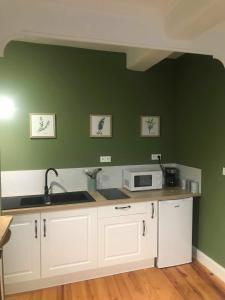 Cuisine ou kitchenette dans l'établissement Comme à la maison