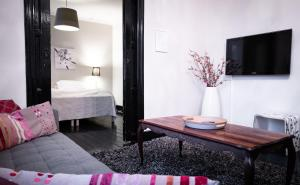 A bed or beds in a room at Luna Apartments