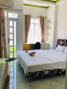 Кровать или кровати в номере ROSE APARTMENT