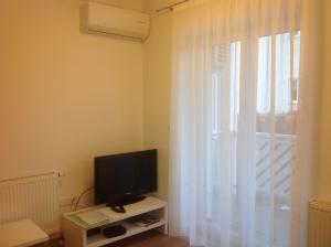 TV in/ali zabaviščno središče v nastanitvi Apartment Aleso