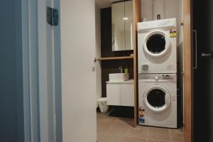A kitchen or kitchenette at Mono Apartments on La Trobe Street
