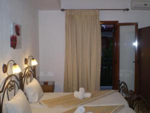 Ένα ή περισσότερα κρεβάτια σε δωμάτιο στο Studios Zoi