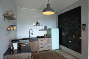 A kitchen or kitchenette at Casa Mafalda