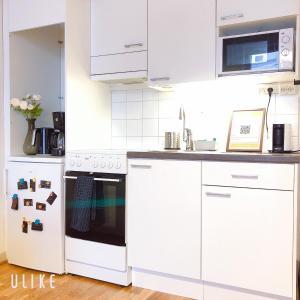 Кухня или мини-кухня в Uman City Studio-Flemingsgatan