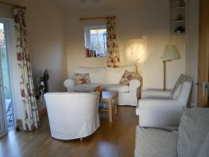 A seating area at Ty'r Afon - River Cottage