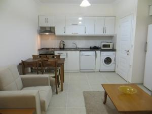 A kitchen or kitchenette at Stella City Apartments