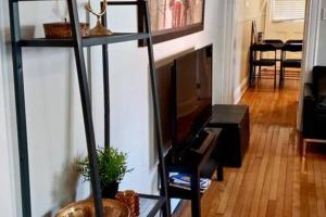 A television and/or entertainment center at G4 · Byward Market 2BD Cozy & Stylish Apartment (G4)