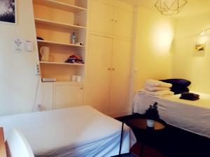A bed or beds in a room at Studio Monsieur Le Prince
