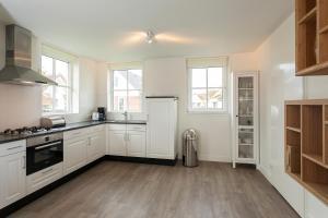 Cucina o angolo cottura di Buitenplaats Witte Raaf aan Zee