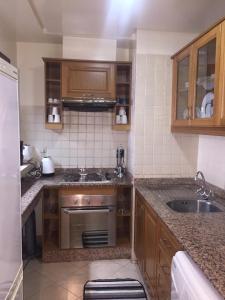A kitchen or kitchenette at Marina Apartment Agadir