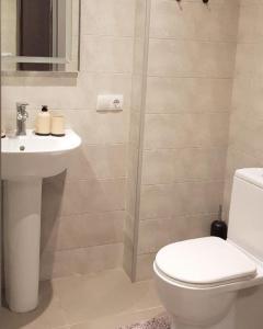 A bathroom at GoodAura by Room 308