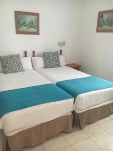 Een bed of bedden in een kamer bij Alisios Playa
