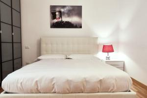 A bed or beds in a room at Borsieri Isola District