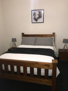 A bed or beds in a room at LOCATED IN THE HEART OF RICHMOND - just off Swan St