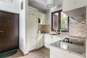 A kitchen or kitchenette at Sunshine of Montenegro Apartments