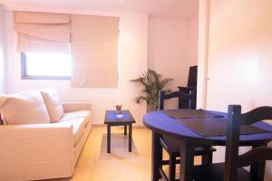 A seating area at apartamento racimo el puerto de santa maria