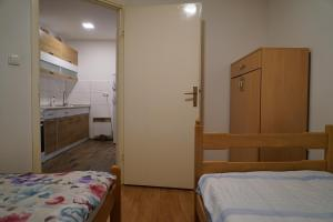 A bed or beds in a room at RS Apartmani