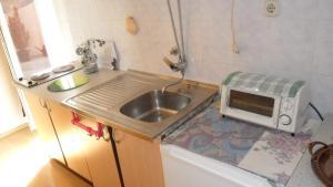 A kitchen or kitchenette at Studio in Rovinj/Istrien 11716