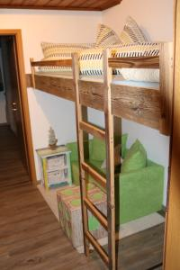 A bunk bed or bunk beds in a room at Ferienhaus Höll