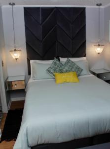 Cama o camas de una habitación en Go Santiago Apartments