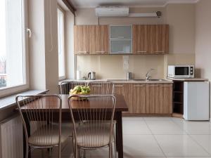 A kitchen or kitchenette at Lux Aparthotel
