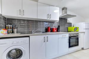 Küche/Küchenzeile in der Unterkunft Crawford Square Apartment