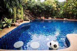 The swimming pool at or near Grand Condo Wasana Pool Villa