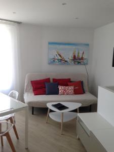 Ein Sitzbereich in der Unterkunft Résidence Les Terrasses de Trestel