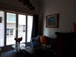 Een zitgedeelte bij Apartment Van Hecke