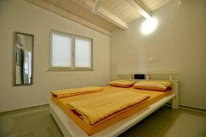A bed or beds in a room at Dalani House