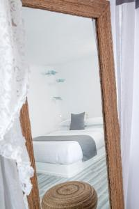 A bed or beds in a room at Mill Houses Elegant Suites