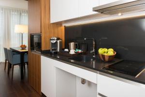 A kitchen or kitchenette at Fraser Suites Geneva - Serviced Apartments