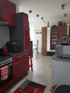 A kitchen or kitchenette at Ferienwohnungen am Krossinsee